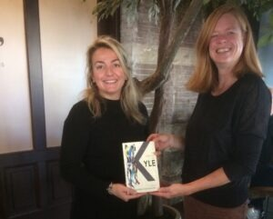 City counsellor accepts a copy of In search of Kyle